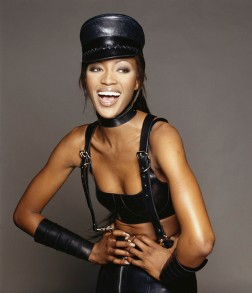 British model Naomi Campbell posing in a leather S&M style outfit with a leather cap. (Photo by Terry O'Neill/Iconic Images/Getty Images)