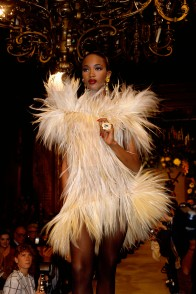 Fashion model Naomi Campbell wears a furry cocktail dress by French fashion designer Yves Saint Laurent at his autumn-winter 1987-1988 fashion show in Paris. Saint Laurent presented his women's haute couture collection at the show. (Photo by Pierre Vauthey/Sygma/Sygma via Getty Images)